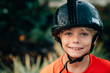 Smiling boy with helmet on