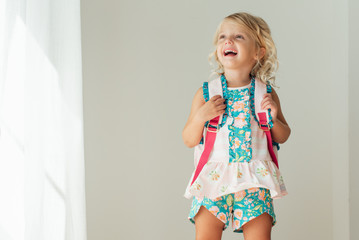 Smiling girl wearing a backpack