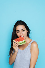 Young woman in bodysuit with watermelon