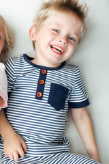 Boy lying down and smiling