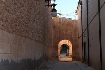 alley in desert old town Bou Saada, Algeria