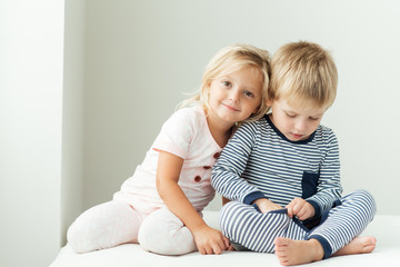 Smiling girl leaning on brother