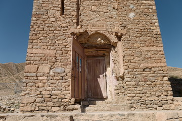 Ancient door in the wall of a tower