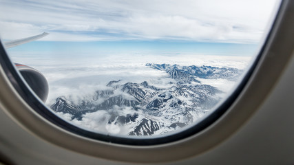 Beautiful view of the Kamchatka mountains from the airplane porthole.