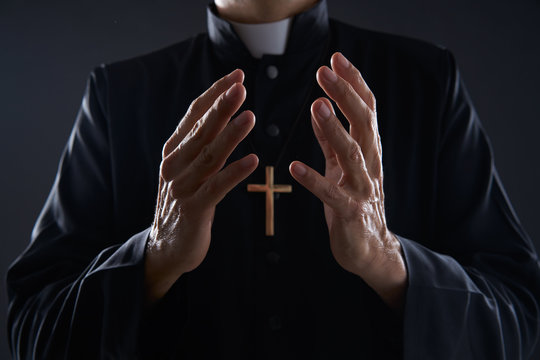 Priest open hands arms praying