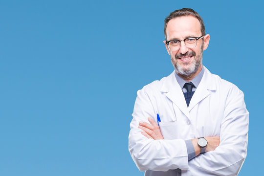 Middle age senior hoary professional man wearing white coat over isolated background happy face smiling with crossed arms looking at the camera. Positive person.