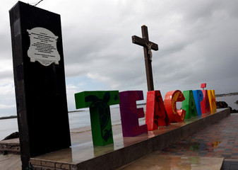 A general view shows a sign at the waterfront in the town of Teacapan near the southern tip of Sinaloa state after Hurricane Willa hit Mexico