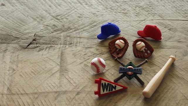 baseball hats gloves ball bats and win banner on a wood background with copy space