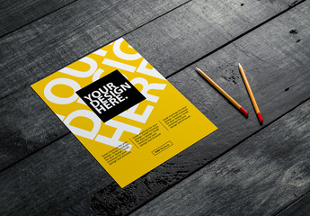 Paper Flyer with Pencils on Wooden Surface Mockup