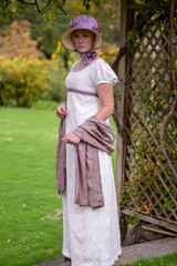 Regency woman in cream embroidered gown
