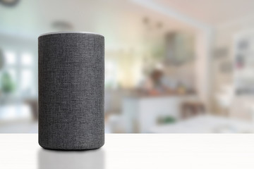 Personal assistant loudspeaker on a white wooden shelf of a smart home kitchen. Empty copy space for Editor's text.