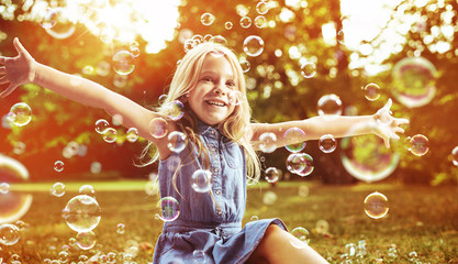 Printed kitchen splashbacks Artist KB Cute little girl playing soap bubbles