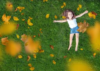 Printed kitchen splashbacks Artist KB Relaxed little girl lying on a fresh, green lawn