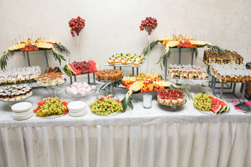 Candy bar. Table with sweets, candies, dessert.