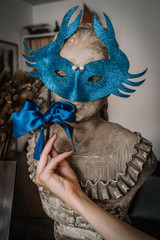 carnival mask and female hand
