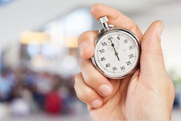 Stopwatch in Human Hand, sport concept