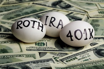 "Three Eggs with the Inscription ""Ira Roth 401K"" on Money"