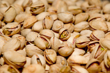 Pistachio texture. Nuts. Green fresh pistachios as texture. Roasted salted pistachio nuts healthy delicious food