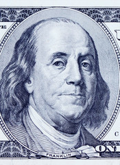 Benjamin Franklin on a US Dollar bill close up. Business and finance concept.
