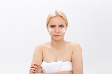 Disappointed young beautiful model sad with her skin on white background.