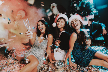 Three Young Women Celebrating New Year on Party.