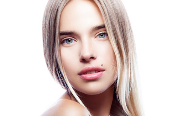 Close-up beauty model girl face looking at camera. Natural lips, nude make-up, healthy clean skin, blond hair, blue eyes. White background. Copy space