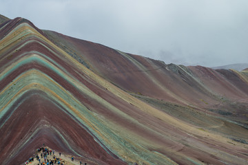 Poster Vinicunca, also called Montaña de Siete Colores, Montaña de Colores or Rainbow Mountain, in a cloudy day, in Perù.