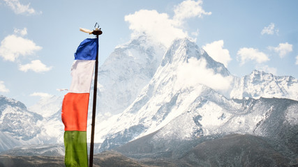 A prayer flag with Ama Dablam in the background