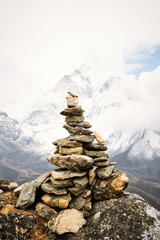 View of cairn marks against snowcapped mountain