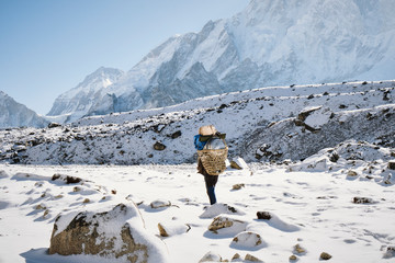 A porter carrying supplies up to Gorakshep in the Himalayas