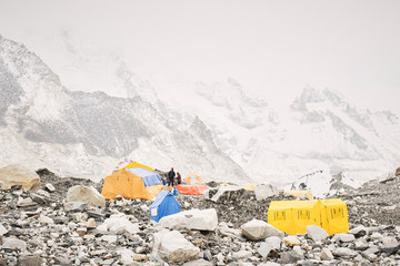 Climbers talking outside their tent in the tent city of Everest Base Camp