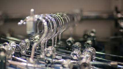 rack of hangers with clothes in line in department store, selective focus, blur