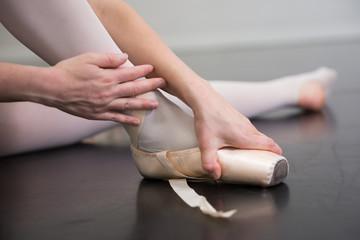 Ballet Dancer Putting on Her Shoes
