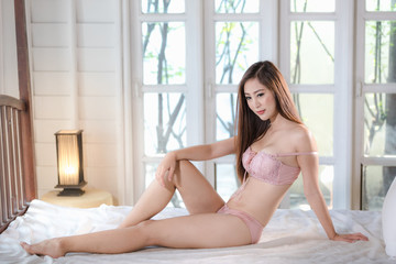 beautiful young model sexy asian girl in underwear on the bedroom