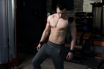 Standing Strong In Gym With Belt