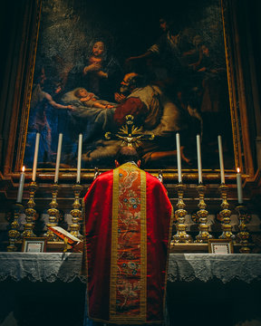 Low Mass in red vestments