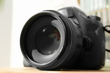 Professional camera on table. Photographer's equipment