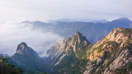 Yellow mountains in the fog at dawn of the sun. Huangshan National Park in China
