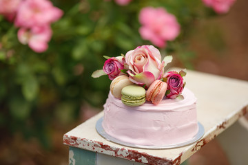 beautiful cake decorated with macaroons and flowers