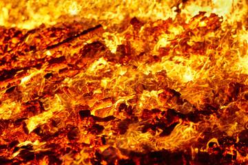 Fire. Volcano incandescent material. Hot charcoal bonfire. Carbon emissions