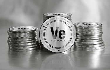Veritaseum (VERI) digital crypto currency. Stack of silver coins. Cyber money.