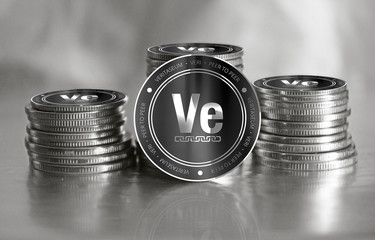 Veritaseum (VERI) digital crypto currency. Stack of black and silver coins. Cyber money.