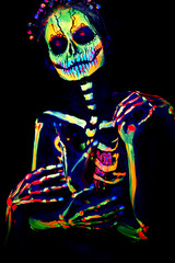 UV body art painting of helloween female skeleton Día de los Muertos