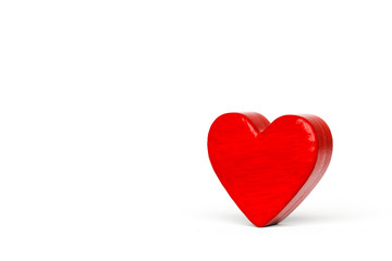 A red wooden hearts on a white background