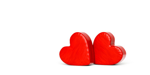 Two red wooden hearts on a white background