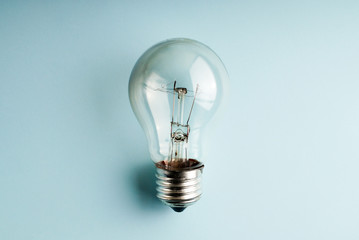 Traditional lightbulb on blue