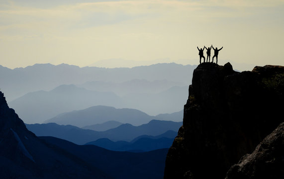 successful climbers, mountain range and spectacular depth