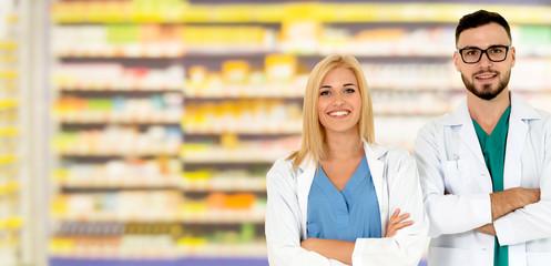 Foto op Plexiglas Bakkerij Pharmacist working with colleague in pharmacy.