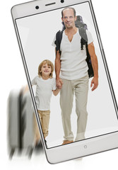 Photo of little happy boy traveling with father on phone s screen, concept of image quality. freezing moving objects in the camera smartphone