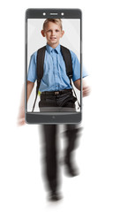 Portrait of young happy smiling blond schoolboy with knapsack. conceptual image with a smartphone, demonstration of device capabilities
